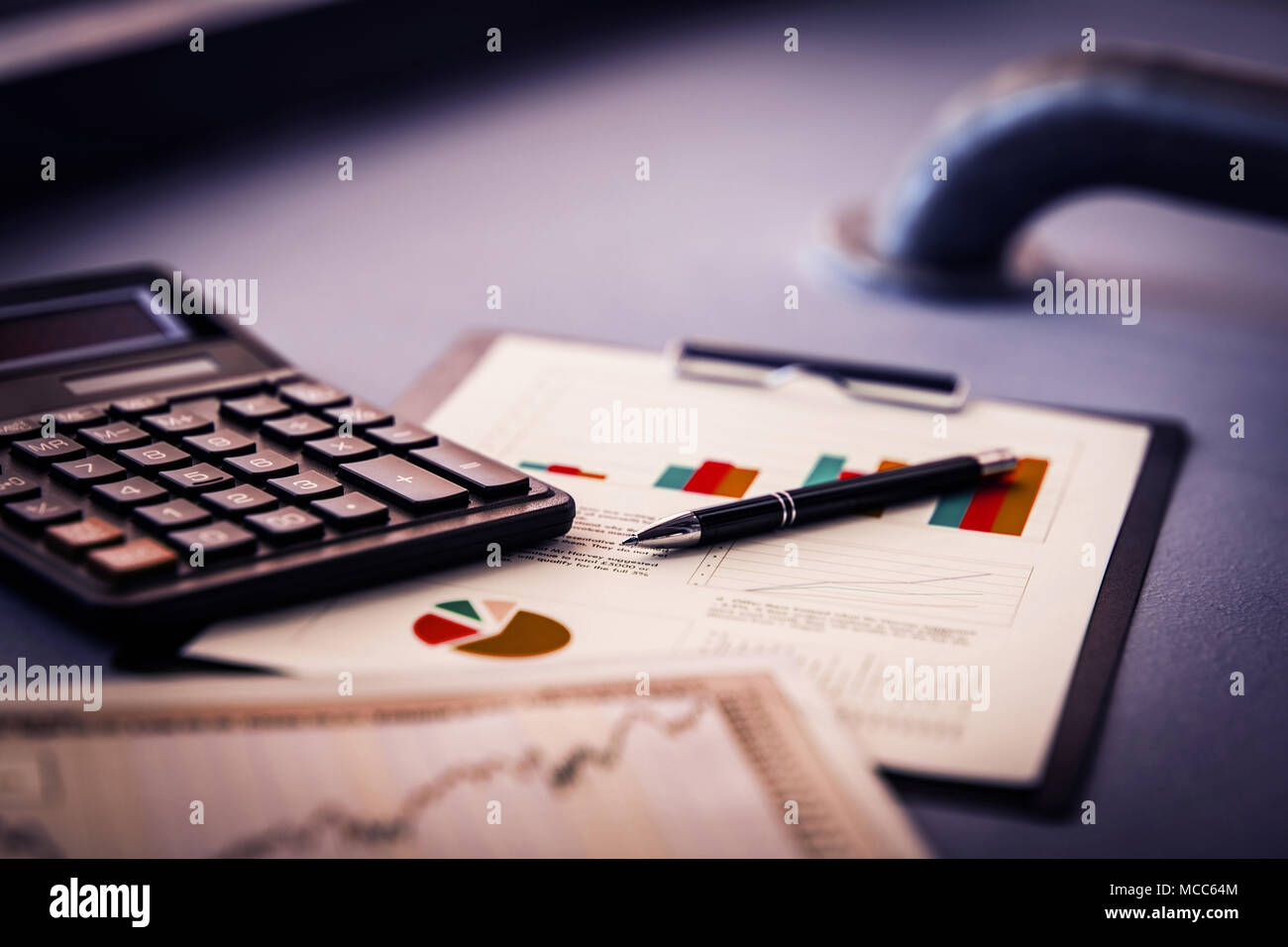 close up. gold-tipped pen and financial chart on the table. - Stock Image