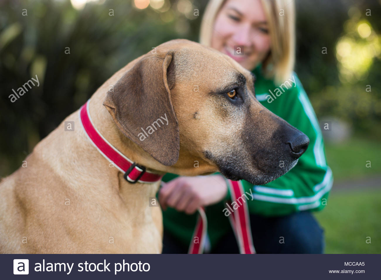 Women wearing dog collar and leash