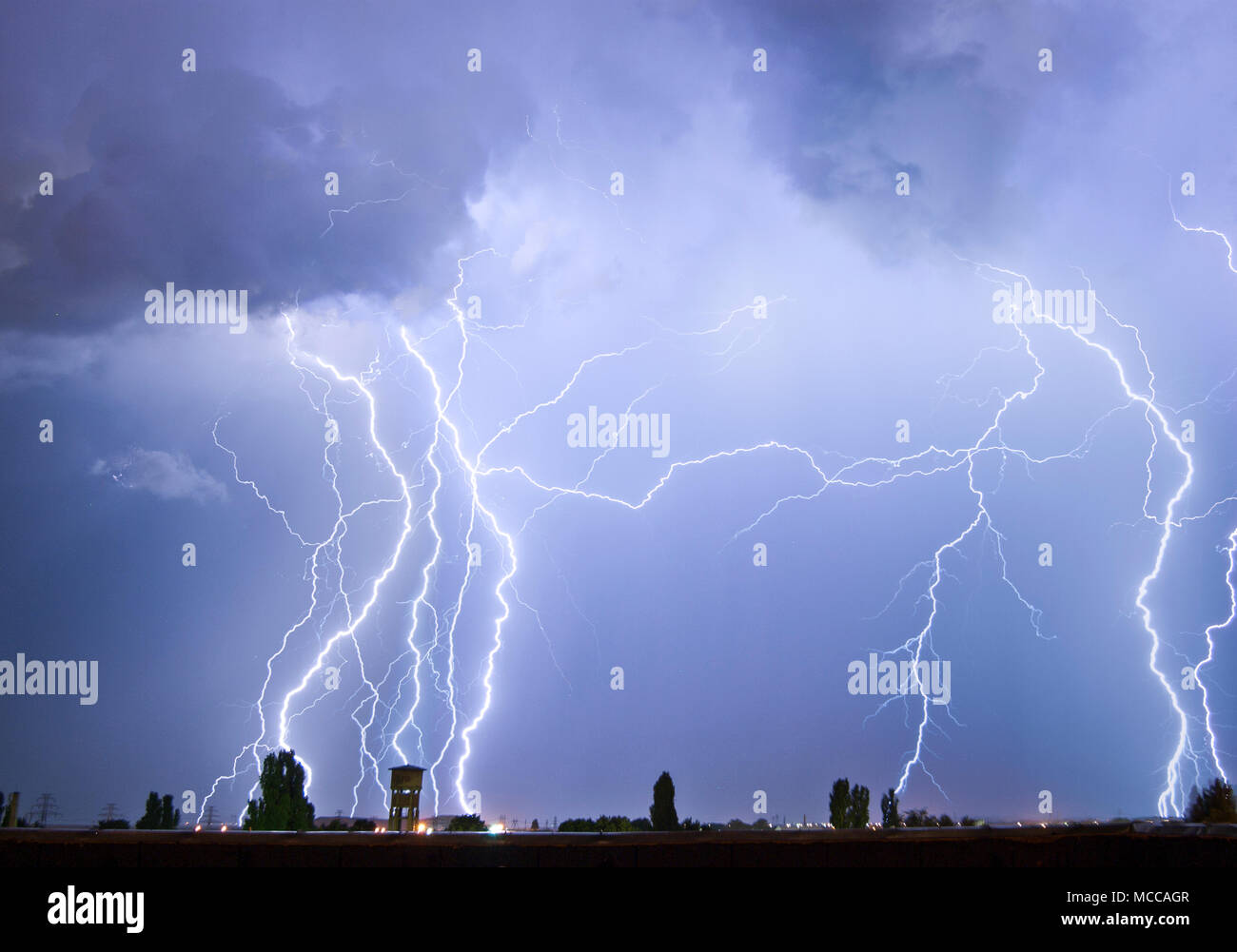 Lightning flash over a city, Thunderstorm , electricity blast storm, thunderbolt in sky Stock Photo