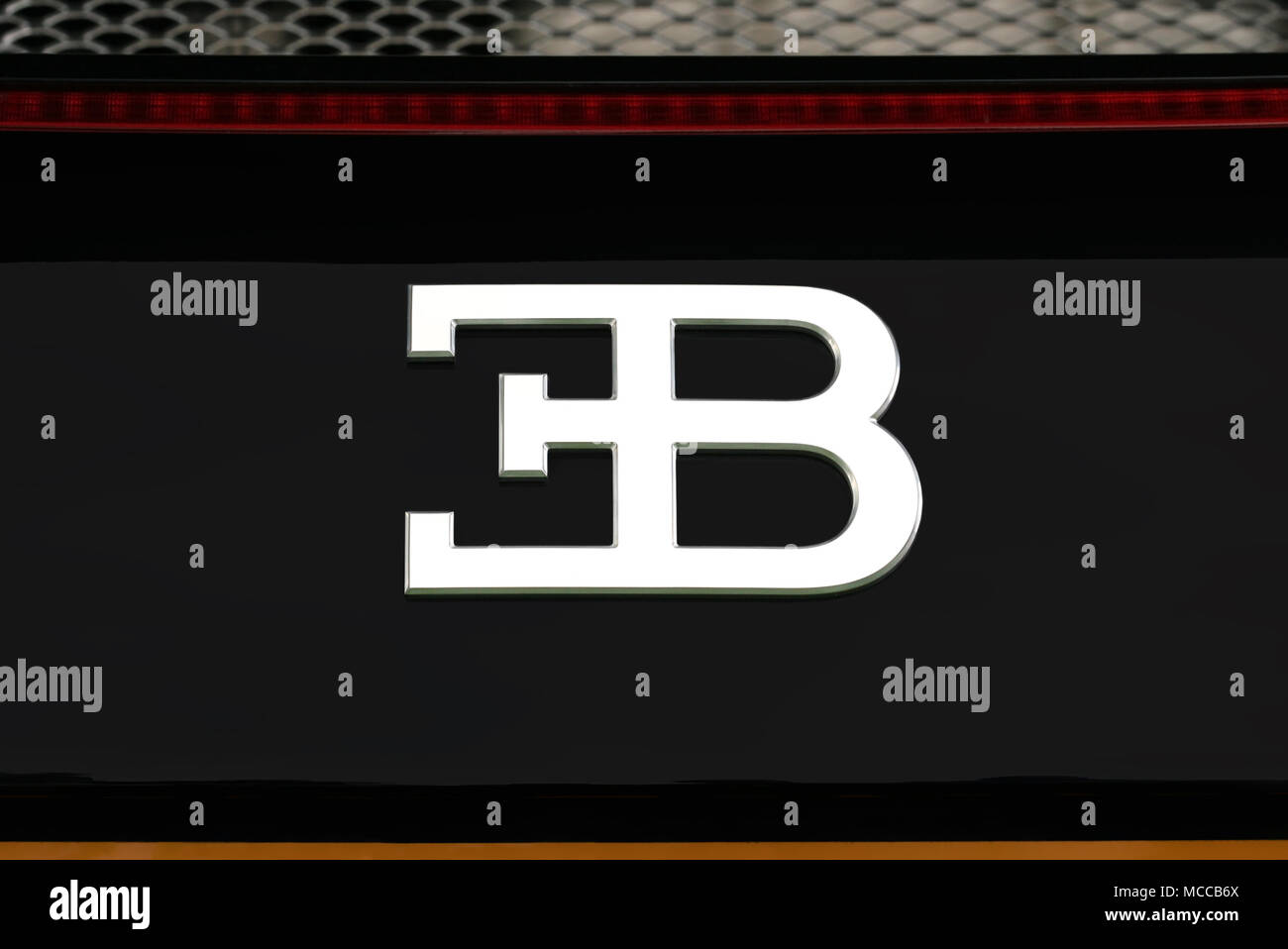Closeup detail of a bugatti logo badge and branding on a black closeup detail of a bugatti logo badge and branding on a black bugatti veyron voltagebd Image collections