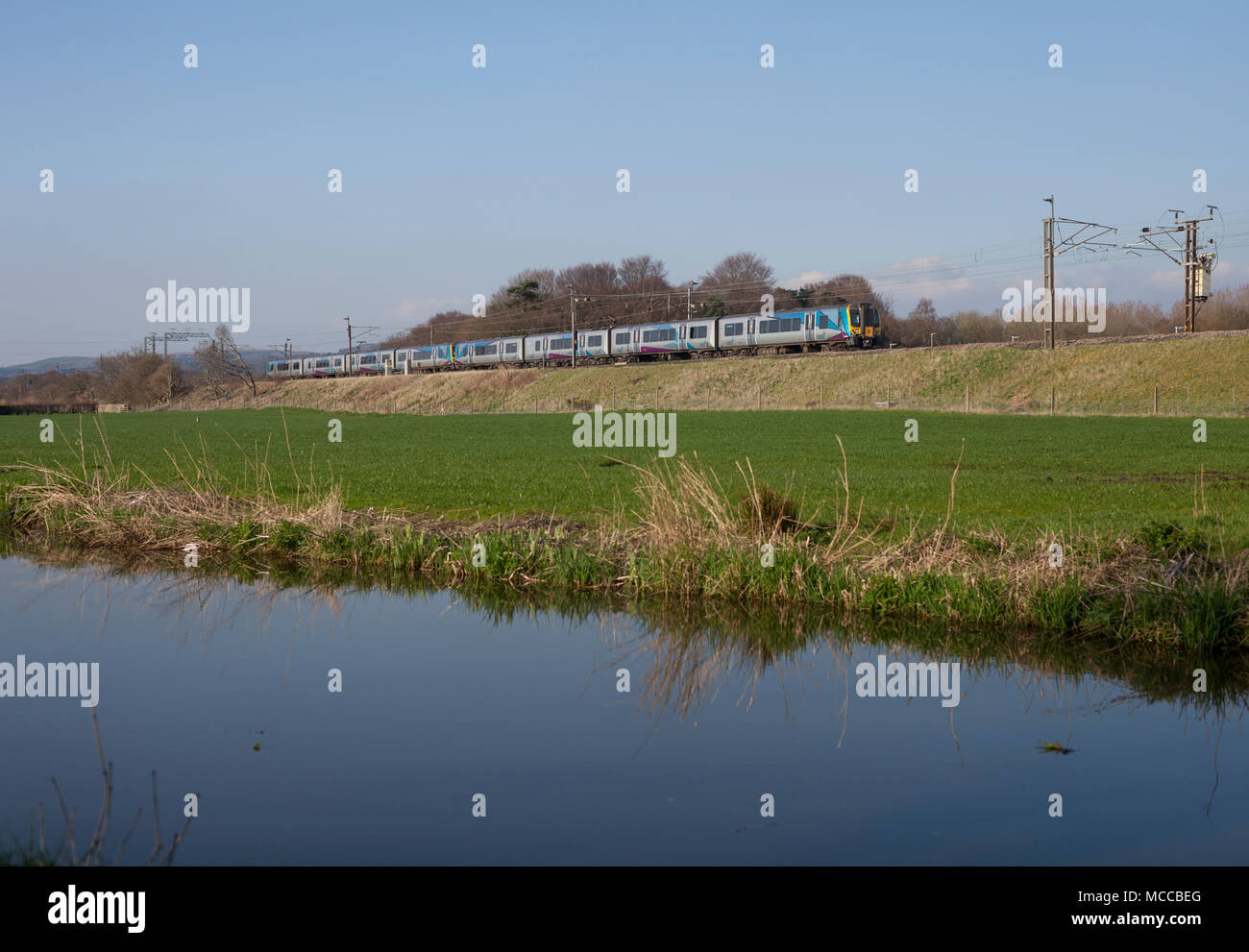 2 Transpennine express class 350 electric trains on the west coast main line passing Catterall, Lancashire - Stock Image