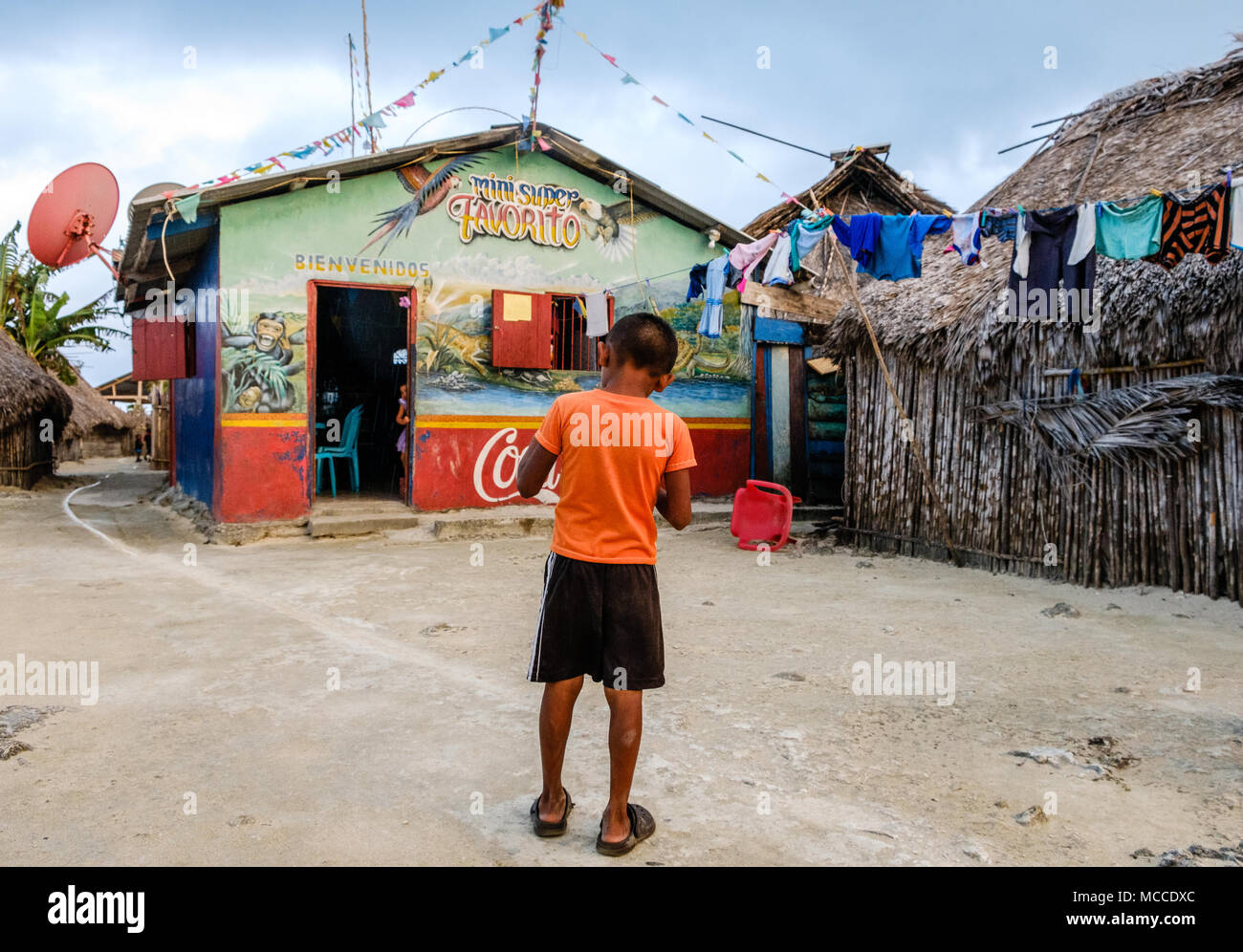 Guna Yala, Panama - march 2018: Boy in front of supermarket (mini super) in rural Kuna Village, San Blas Islands - Stock Image