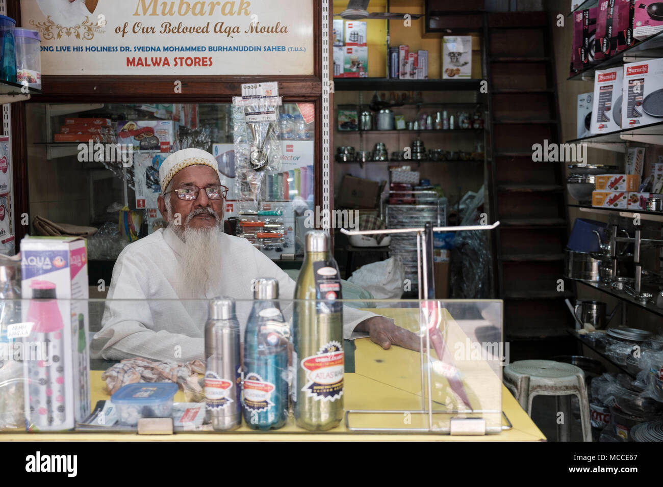 A bearded Muslim shop seller in a store in Mumbai - Stock Image