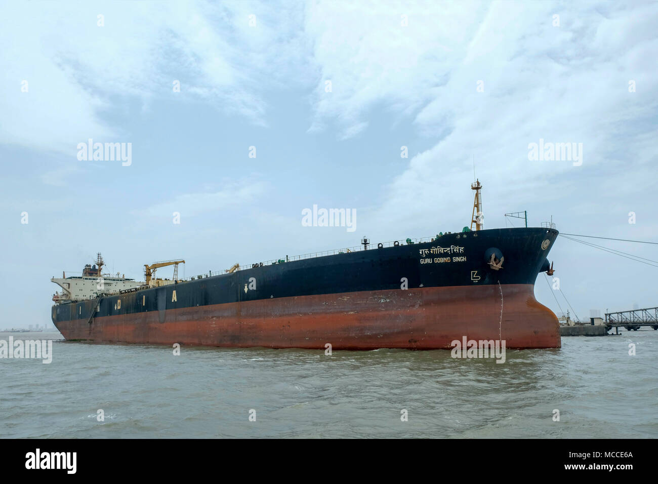 The Guru Gobind Singh crude oil tanker in the port in Mumbai, India - Stock Image