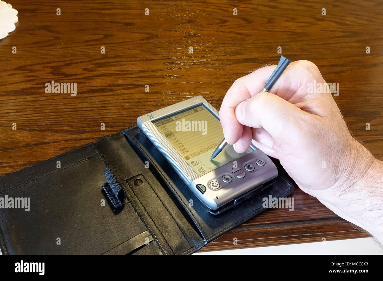 Using a PDA (Handspring Visor) - Stock Image
