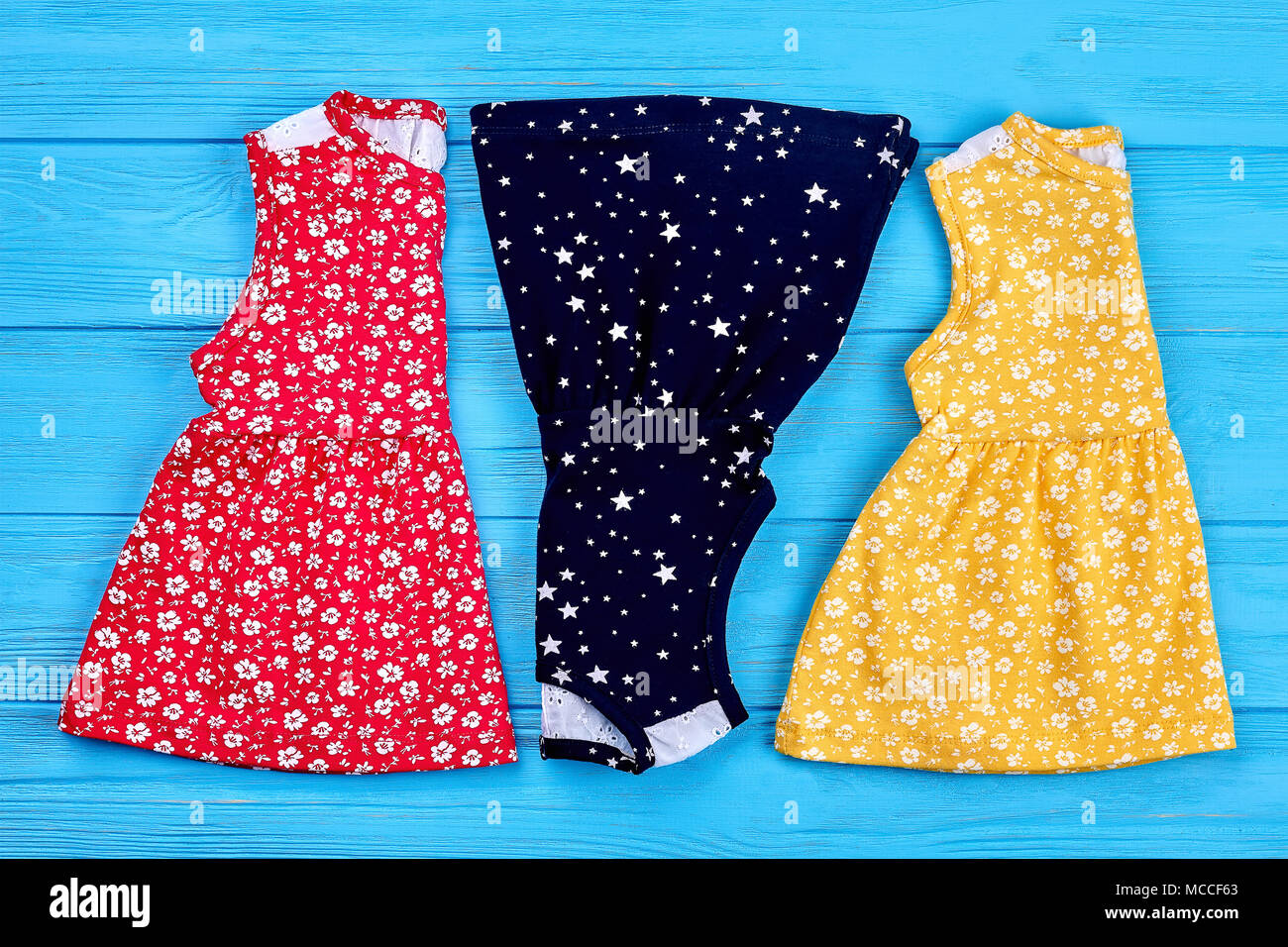 4caa574d2 New folded baby summer dresses. Collection of natural toddler girls  sundresses on shop shelf. Cute vintage baby-girl dresses on sale.
