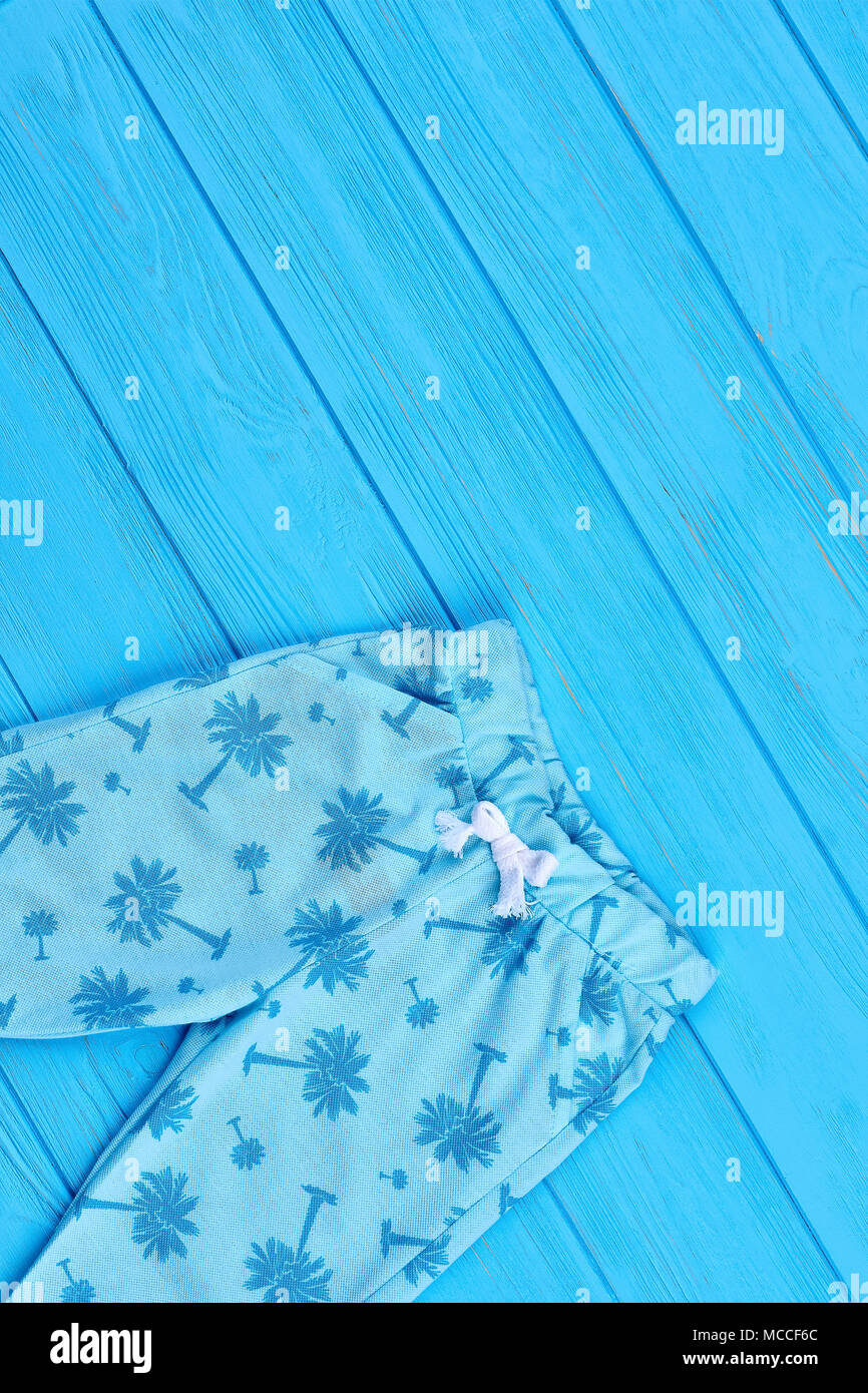 fdd7fe85f5736 Top view of blue toddlers leggings. Printed capri leggings for toddler girls  and copy space. Blue childs pants on blue wooden background.