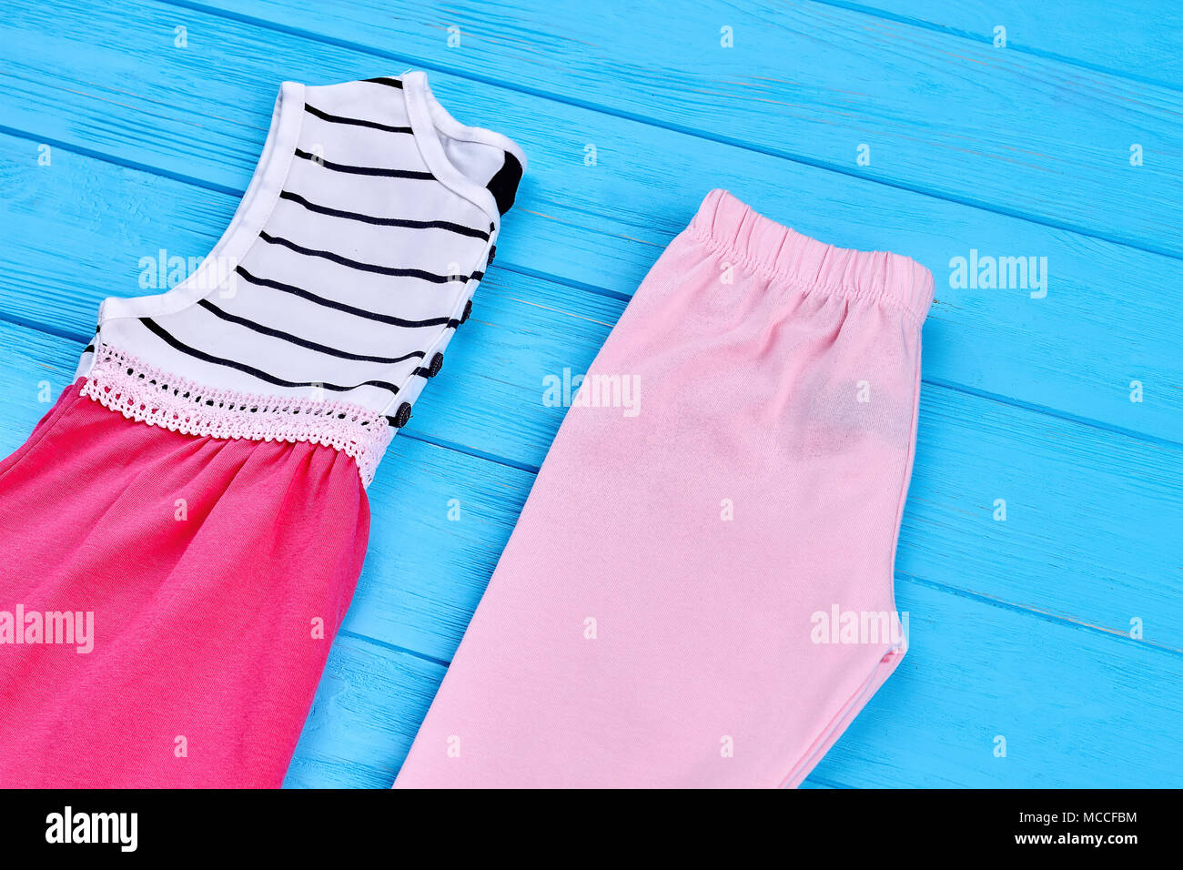 8c4145df38418 Little girl summer clothes background. New folded cotton garment for  toddler girl. Shop beautiful natural kids apparel.