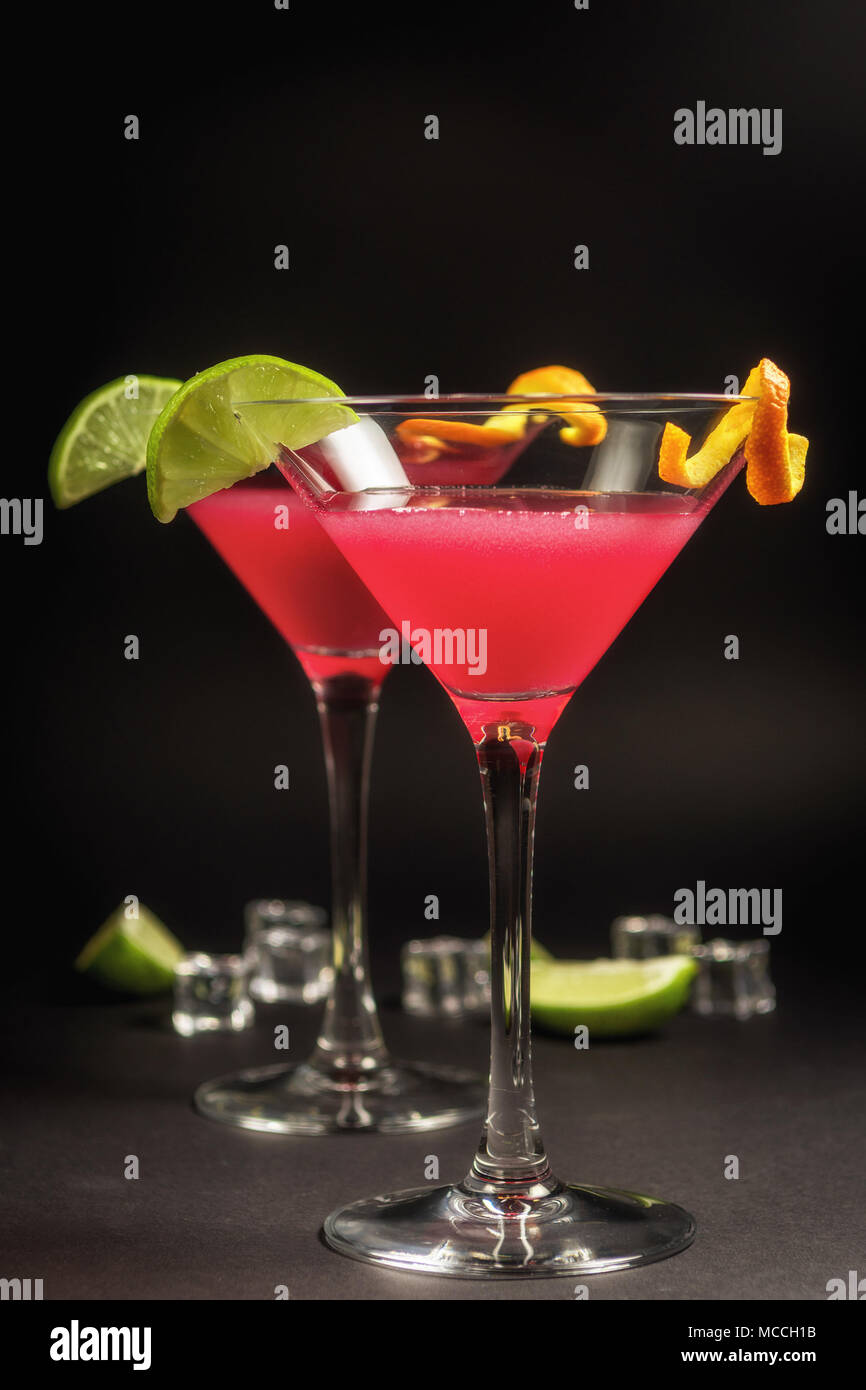 Alcohol drink cocktail Cosmopolitan with lime on black background Stock Photo
