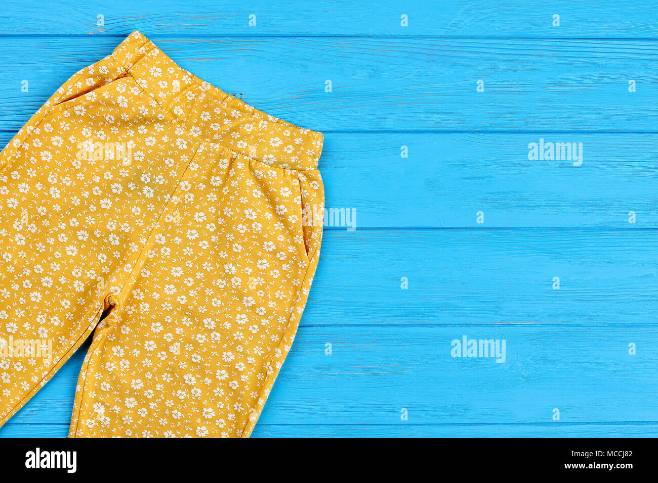 Yellow Baby Leggings And Copy Space Infant Girl Colored Pants On Blue Wooden Background Copy Space Stock Photo Alamy