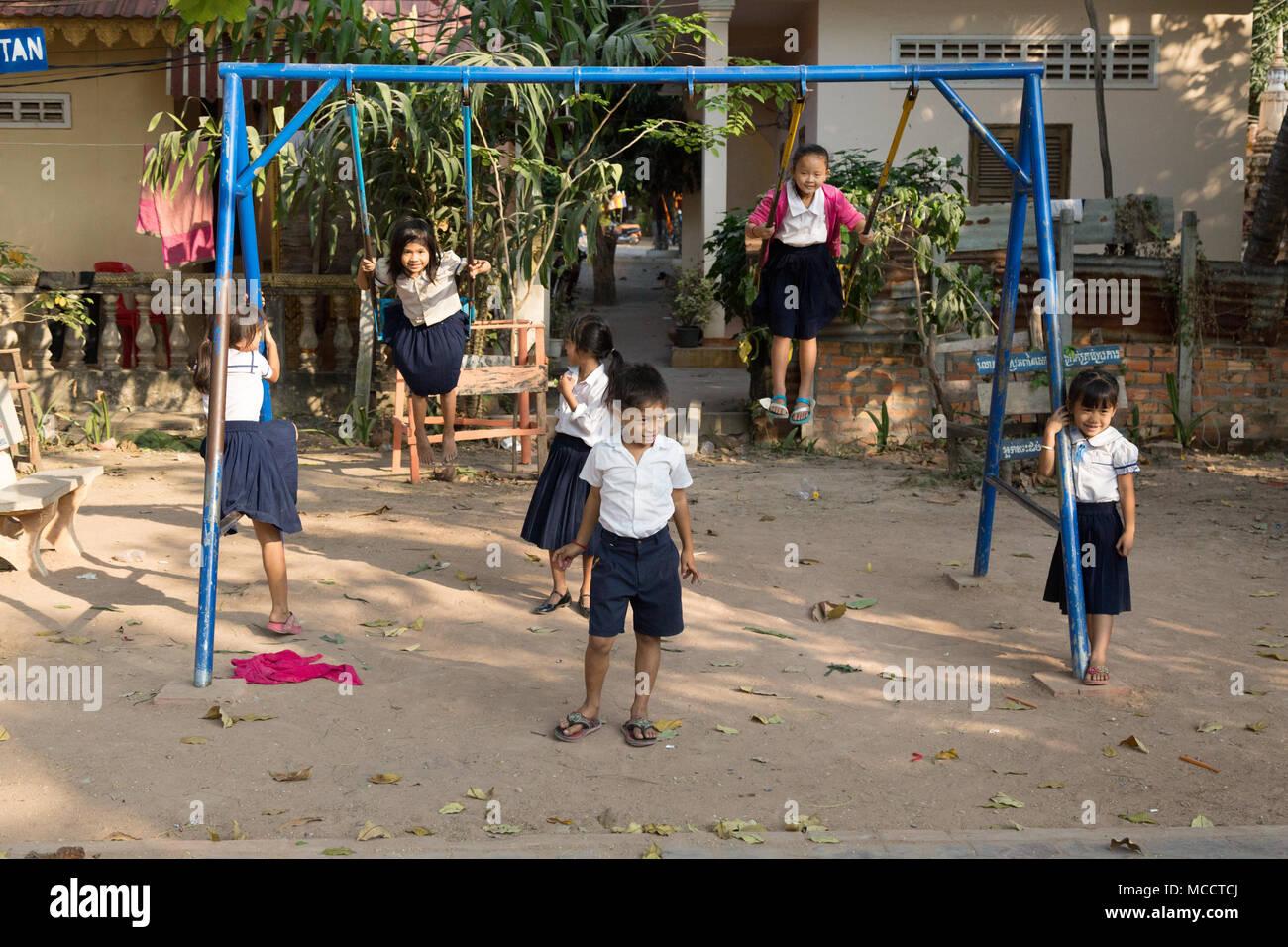 Asian schoolchildren - Cambodian primary school children in school playground, Siem Reap, Cambodia, Asia - Stock Image