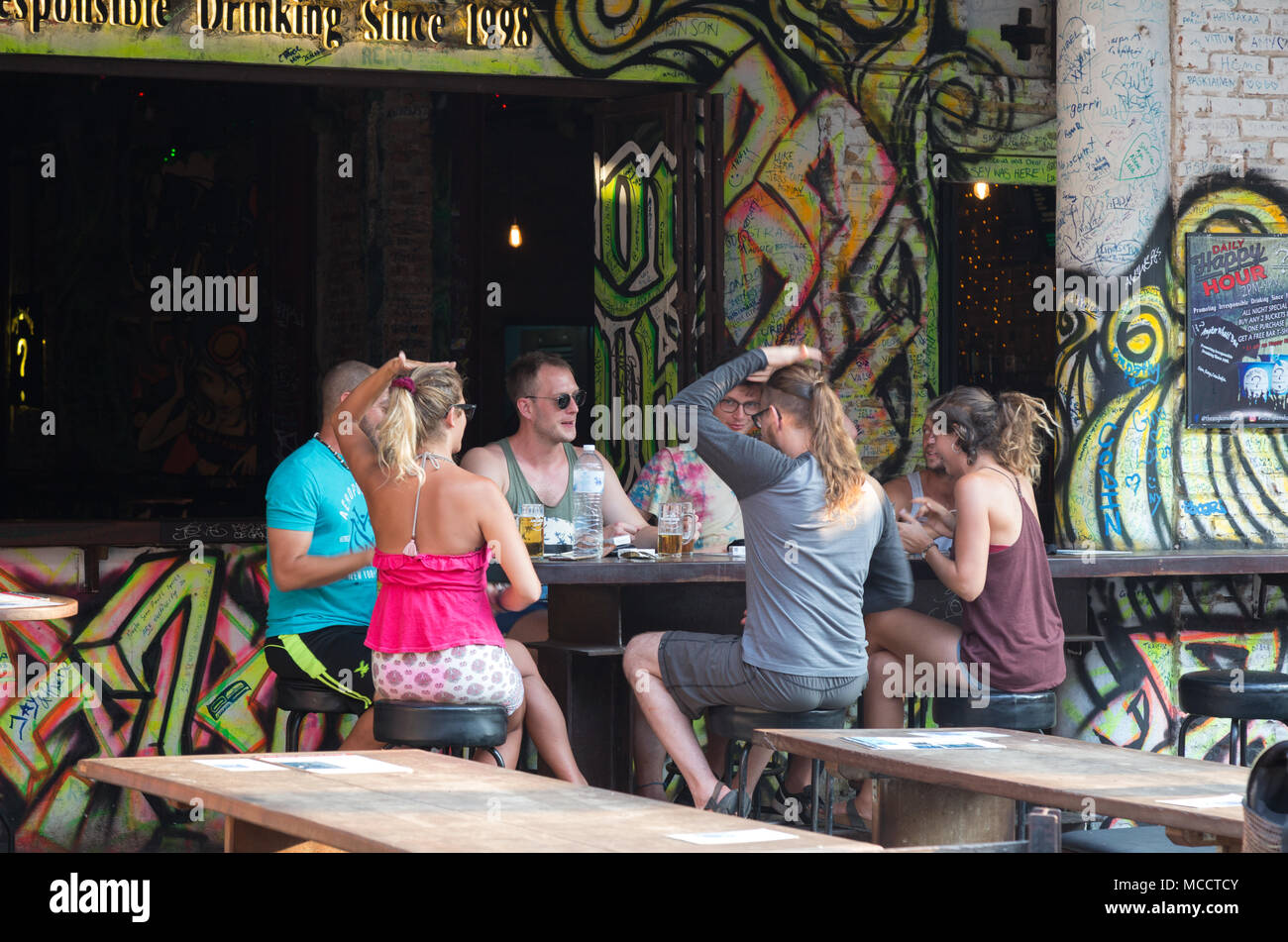 People on holiday  playing drinking games in a bar, Pub Street, Siem Reap, Cambodia Asia - Stock Image