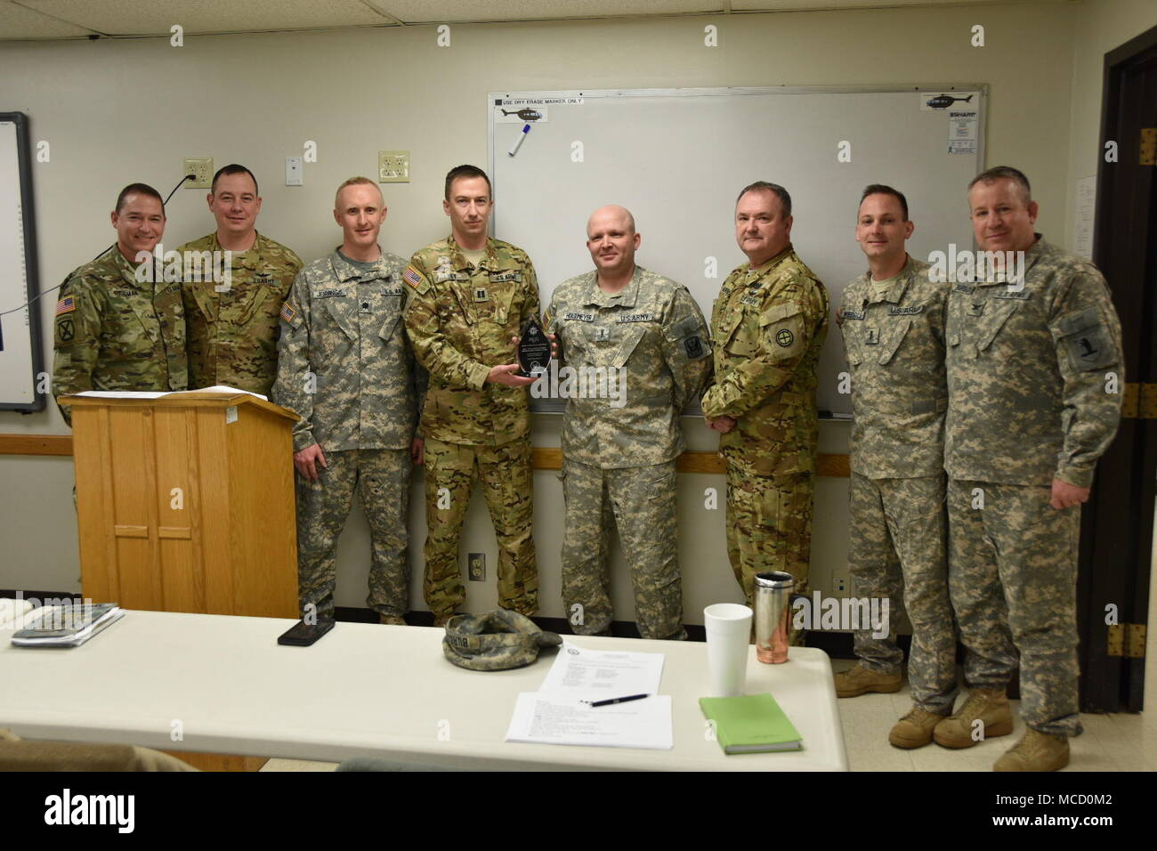 Members of the Missouri Army National Guard's Detachment 2, Company C of the 2-245th Aviation Regiment gather in Jefferson City, Missouri, with a trophy recognizing their achievement of having been named 2017 Joint Operational Support Airlift Center Unit of the Year in the Army National Guard – West category by the U.S. Transportation Command, Feb. 8, 2018. Detachment 2 is responsible for operating and maintaining the state's C-12 Huron, a military passenger and transport aircraft, and provides direct support for the U.S. Transportation Command, one of nine unified Department of Defense comman Stock Photo