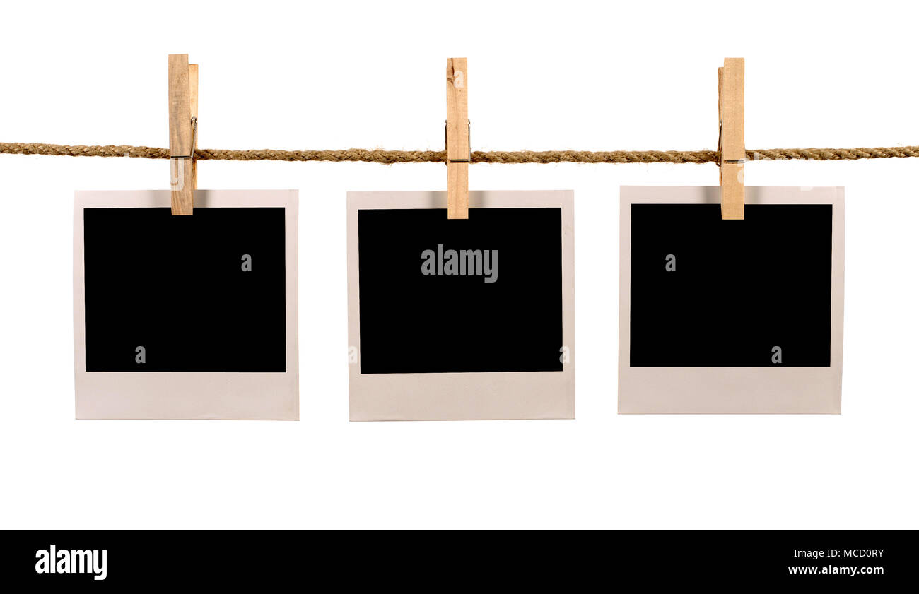 Several blank polaroid style instant photo print frames hanging on a ...