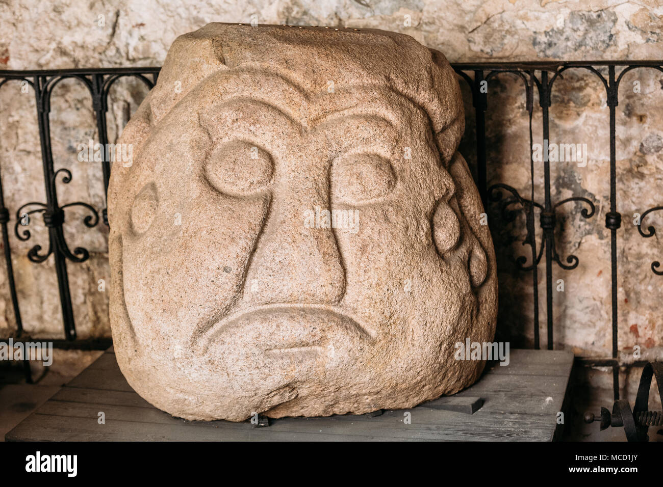Riga, Latvia - July 2, 2016: Salaspils Stone Head Is Stone Statue Of Ancient Slavic Idol In Museum Of Dome Cathedral. Monument Has A Height - 0,83 M,  - Stock Image