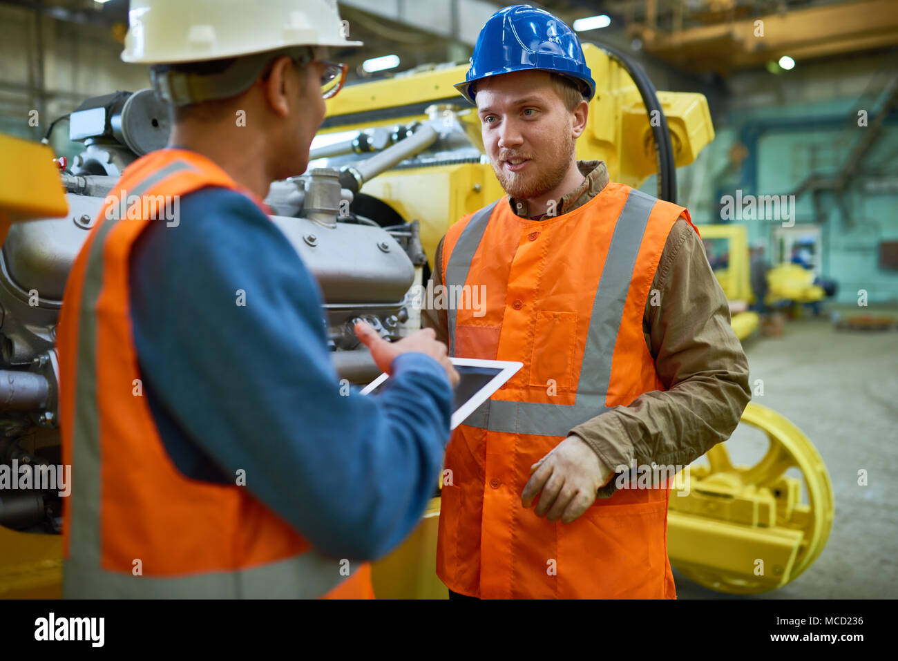 Solving Faced Problems with Colleague - Stock Image