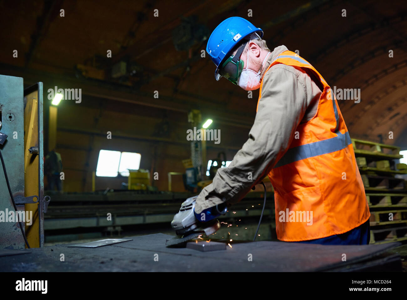 Highly Professional Worker Using Angle Grinder - Stock Image