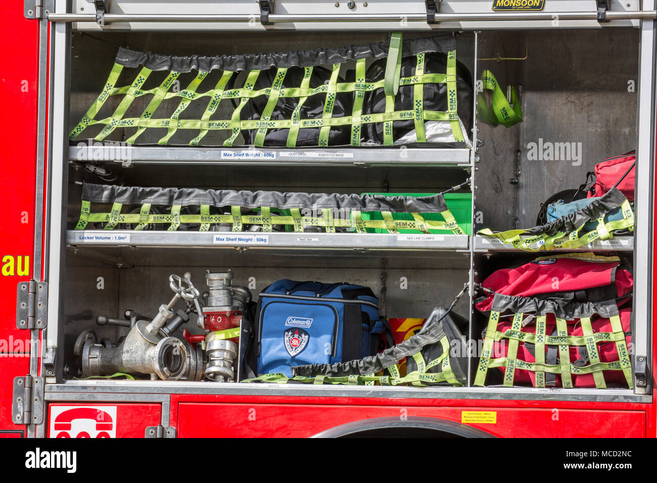 Equipment inside NSW fire tender truck in Sydney Stock Photo