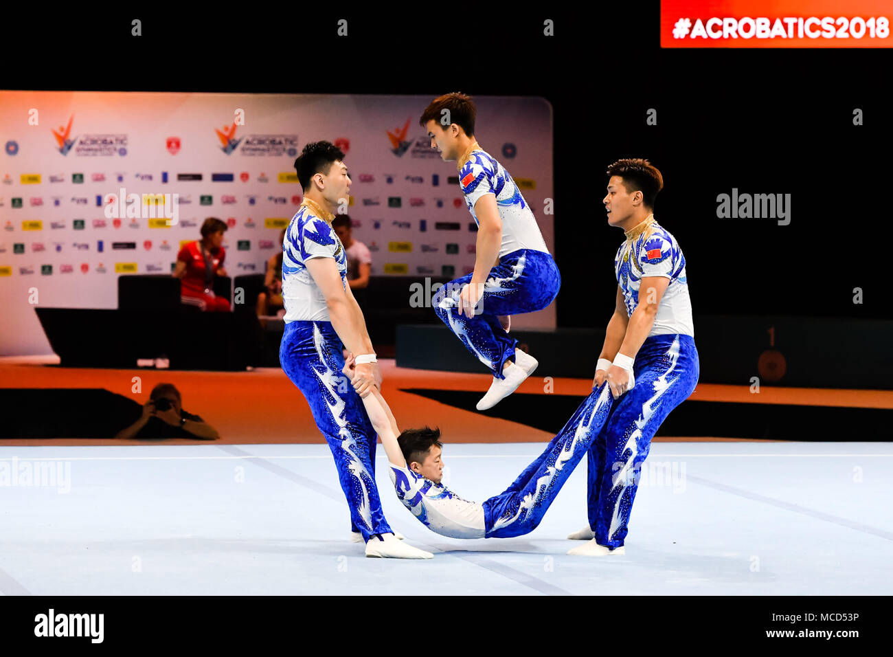 Antwerp, Belgium. 15th April 2018. Fu Zhi, Guo Fei, Jiang Heng and Zhang Junshuo  (CHN) are competing in Men's Group Qualify during the 26th World Championships Acrobatics Gymnastics 2018 at Lotto Arena on Sunday, 15 April 2018. ANTWERP, BELGIUM. Credit: Taka G Wu Credit: Taka Wu/Alamy Live News - Stock Image