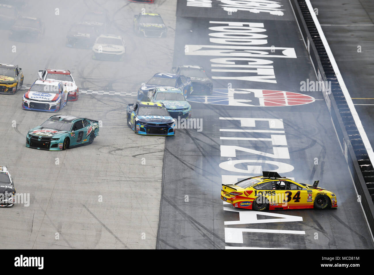 Bristol, Tennessee, USA. 15th Apr, 2018. April 15, 2018 - Bristol, Tennessee, USA: Michael McDowell (34) and Chase Elliott (9) spin to the infield to bring out a caution during the Food City 500 at Bristol Motor Speedway in Bristol, Tennessee. Credit: Chris Owens Asp Inc/ASP/ZUMA Wire/Alamy Live News - Stock Image
