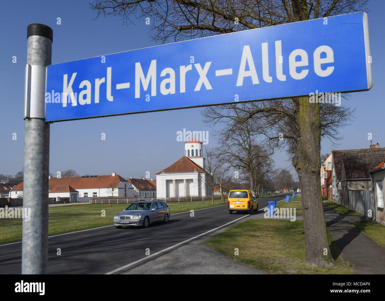 10 April 2018, Germany, Neuhardenberg: A street signe reads Karl-Marx-Allee. The town was previoulsy known as Marxwalde after German philosopher, economist and social theorist Karl Marx (May, 05 1818 - March, 14 1883) during the GDR era and renamed to Neuhardenberg after the fall of the Berlin Wall. Photo: Patrick Pleul/dpa-Zentralbild/dpa Stock Photo