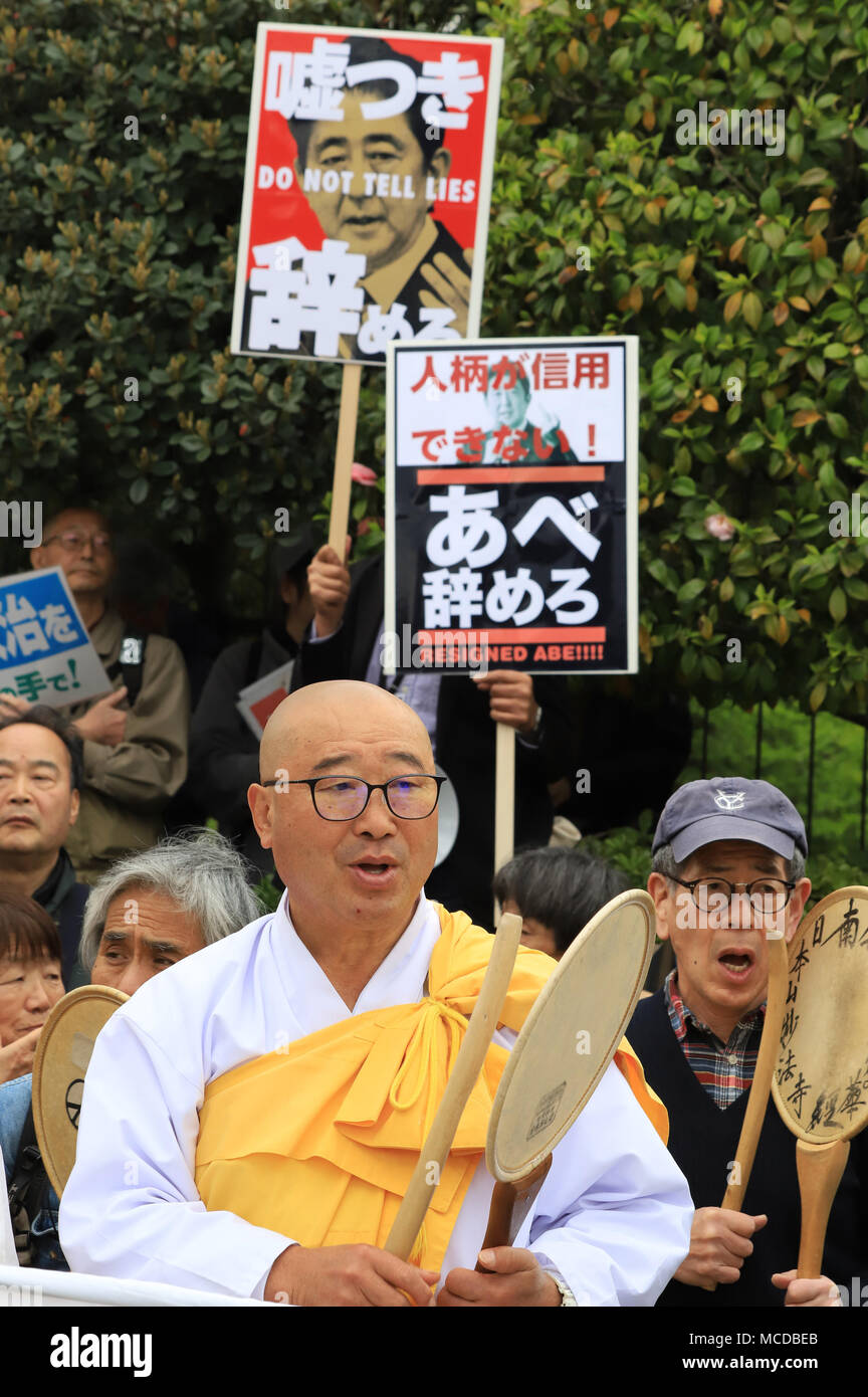 Tokyo, Japan. 14th Apr, 2018. A Buddhist monk and believers beat drums to protest against Abe cabinet at a rally in front of the National Diet in Tokyo on Saturday, April 14, 2018. Tens of thousands people gathered to demand resignation of Prime Minister Shinzo Abe for the Moritomo and Kake scandals. Credit: Yoshio Tsunoda/AFLO/Alamy Live News - Stock Image
