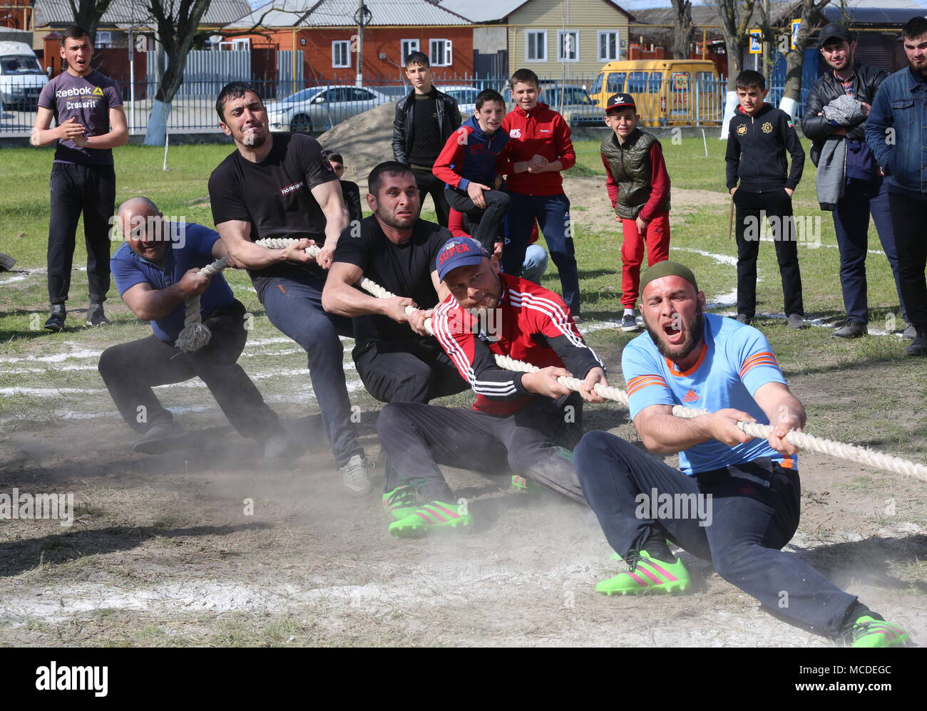 Russia. 15th Apr, 2018. CHECHNYA, RUSSIA - APRIL 15, 2018: Men compete in a tug of war contest as part of the first Republican Cossack Games held by the Terek Cossacks community in the village of Novoshchedrinskaya, Shelkovskoi District. The Chechen Republic's Terek and Sunzha Cossack community comprises six Cossack communities in Naursky and Shelkovskoi Districts. Yelena Afonina/TASS Credit: ITAR-TASS News Agency/Alamy Live News - Stock Image