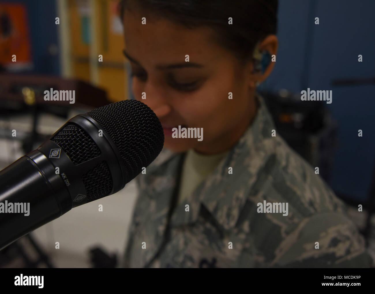 Tech  Sgt  Nalani Quintello, Max Impact singer, prepares to