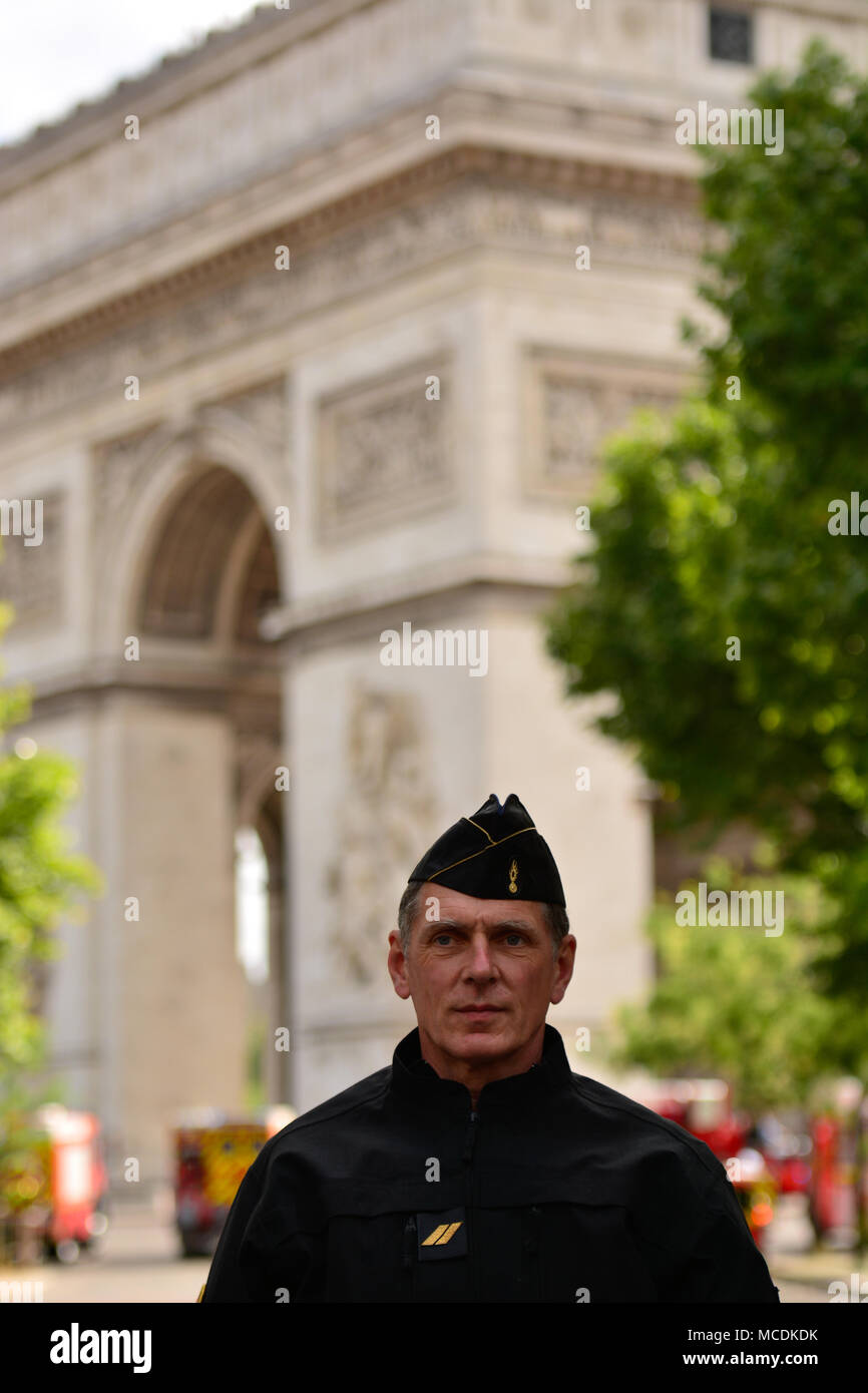e7ffb453bf A French officer standing in front of the Arc de Triomphe during the  Bastille Day in