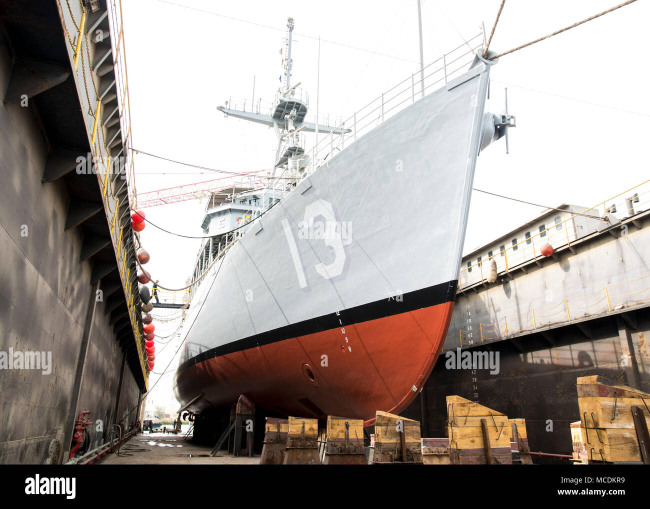The mine countermeasures ship USS Dextrous (MCM 13) sits in dry dock for maintenance at Manama, Bahrain, Feb. 21, 2018. Dextrous is part of Naval Surface Squadron (CNSS) 5, which serves as the surface type commander's executive agent in Bahrain and provides support to 10 Cyclone-class coastal patrol ships and four Avenger-class mine countermeasures ships. (U.S. Navy photo by Mass Communication Specialist 2nd Class Victoria Kinney) - Stock Image