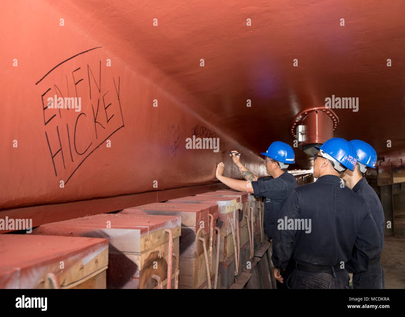 180221-N-XP344-032 MANAMA, Bahrain (Feb. 21, 2018) Sailors assigned to U.S. Navy mine countermeasures ship USS Dextrous (MCM 13) sign the ship's keel. Dextrous is a part of Naval Surface Squadron (CNSS) 5, which serves as the surface type commander's executive agent in Bahrain and provides support to 10 Cyclone-class coastal patrol ships and four Avenger-class mine countermeasures ships. (U.S. Navy photo by Mass Communication Specialist 2nd Class Victoria Kinney/Released) - Stock Image