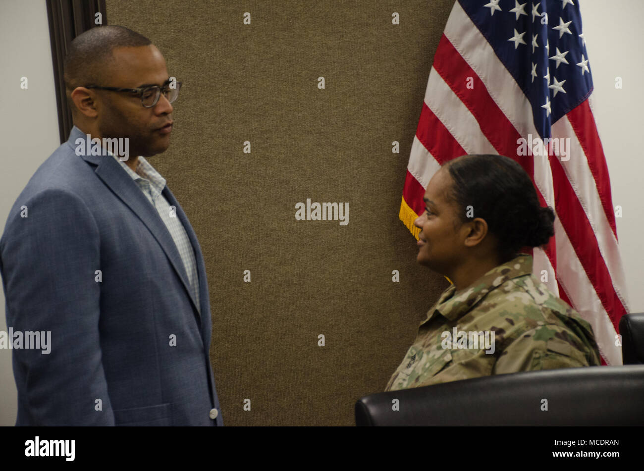GRAND PRAIRIE, TX - Congressman Marc Veasey, representative of the 33rd District of Texas speaks with Master Sgt. Barbara Bossier, 300th Sustainment Brigade, before the congressman's constituents meeting at Grand Prairie Armed Forces Reserve Complex, Grand Prairie, Texas, February 20, 2018.  The congressman held an open forum attended by Soldiers, Marines and family members to talk about various community issues and how they personally affect members of the military's reserve units. (U.S. Army Reserve photo by Sgt. Raymond Maldonado, 206th Broadcast Operations Detachment/Released) - Stock Image