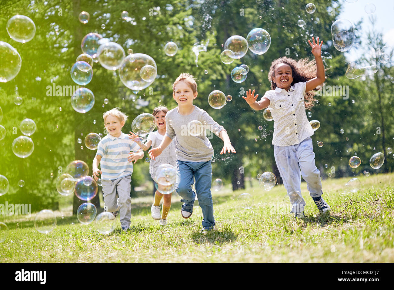Little Kids Having Fun Outdoors - Stock Image