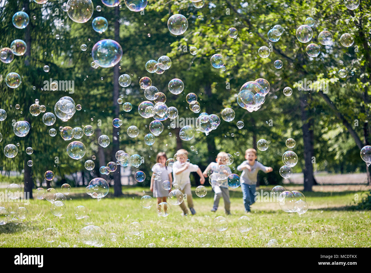 Playing Active Games Outdoors - Stock Image