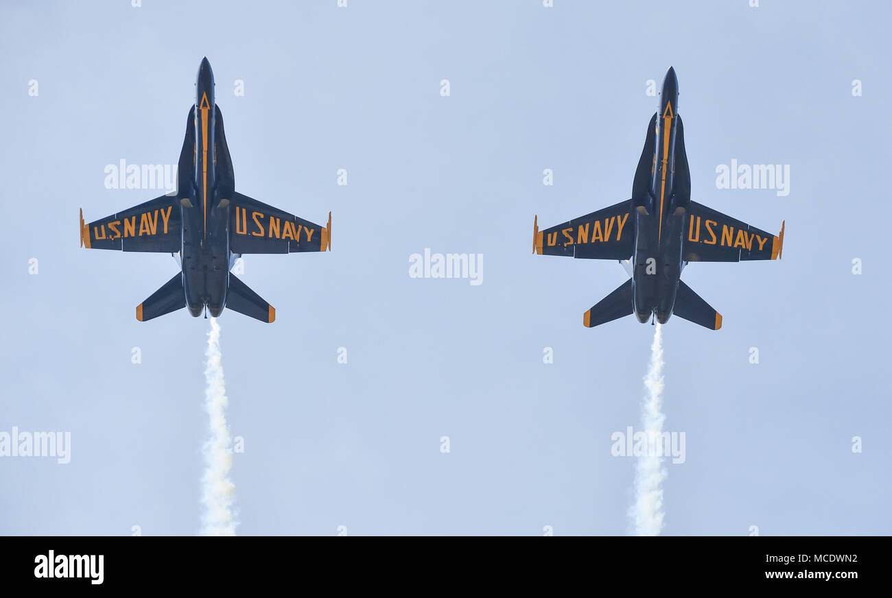 180412-N-NI474-2230  TUSCALOOSA, Ala. (April 12, 2018) The U.S. Navy flight demonstration squadron, the Blue Angels, Solo pilots perform the Opposing Minimal Radius Turn maneuver during a practice demonstration for the Tuscaloosa Regional Air Show. The Blue Angels are scheduled to perform more than 60 demonstrations at more than 30 locations across the U.S. and Canada in 2018. (U.S. Navy photo by Mass Communication Specialist 1st Class Daniel M. Young/Released) - Stock Image