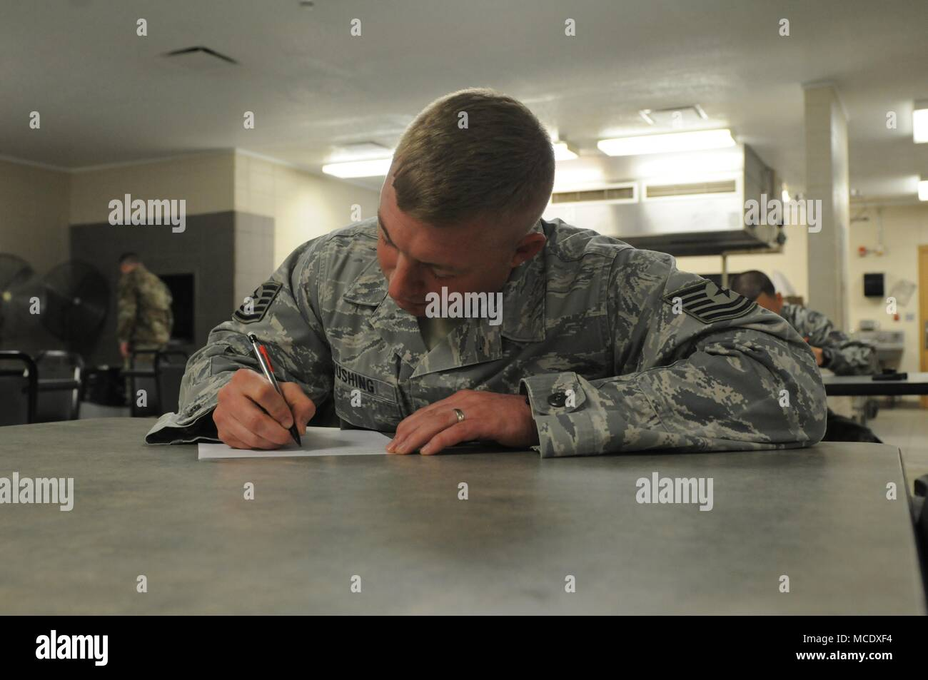 Mississippi Air National Guard Tech Sgt. Thomas D. Rushing, 186th Security Forces Squadron, takes an exam during the opening event of the Mississippi Best Warrior Competition Feb. 26, 2018. The Best Warrior Competition highlights the various skills and expertise our Soldiers and Airmen contribute to the National Guard team and our all-volunteer force. (U.S. National Guard photo by Chelsy Ables) - Stock Image