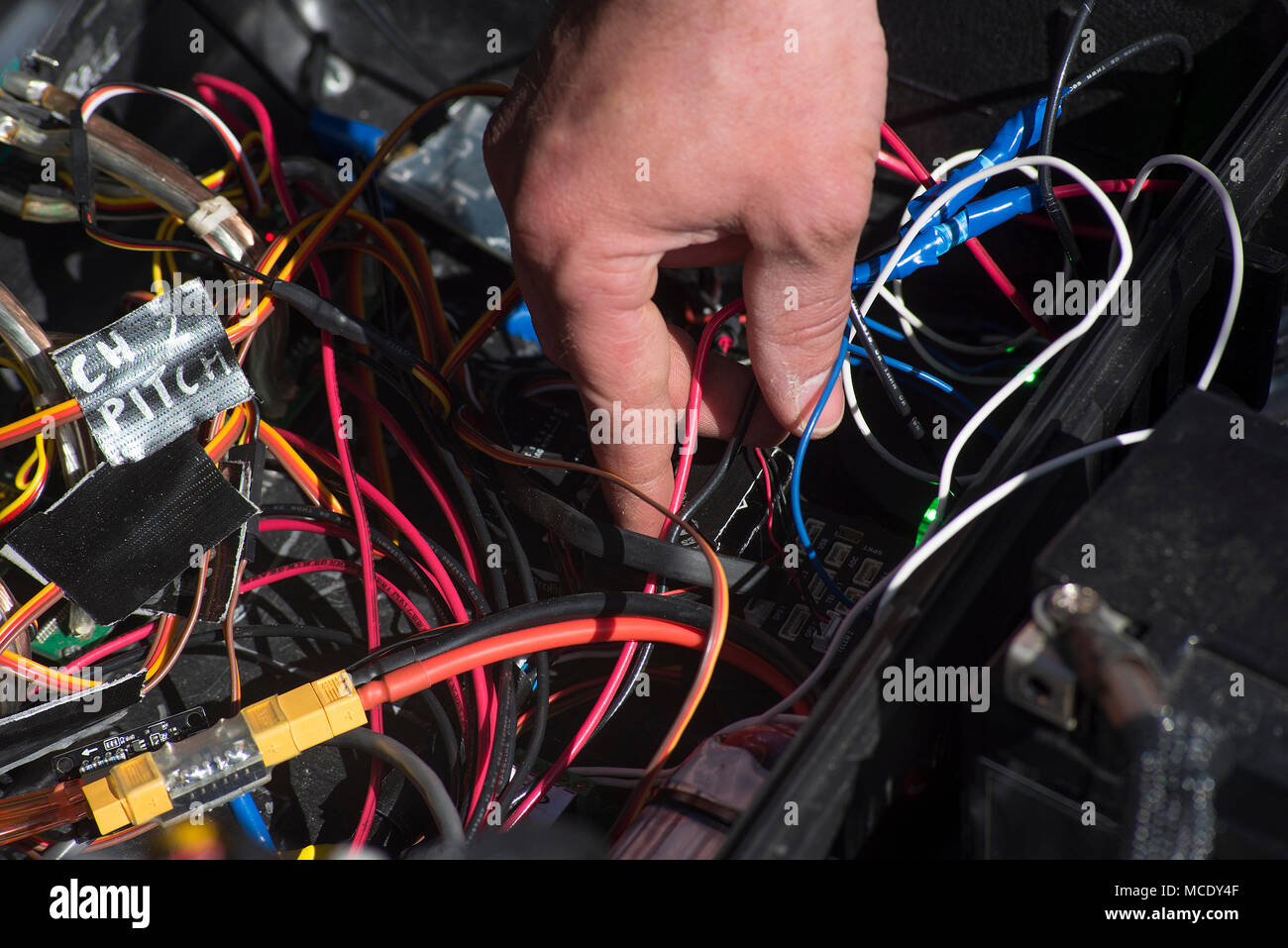 A Competitor Reaches Into Tangle Of Wires Feb 26 2018 While Redstone Wiring For Dummies Trouble Shooting Problem With Radio Controlled Aircraft Prior To The Start