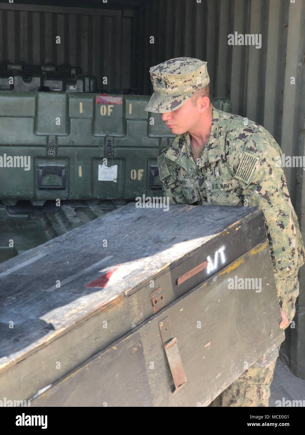 Construction Electrician 3rd Class Enes Cimbat,  a Seabee assigned to Naval Mobile Construction Battalion (NMCB) 11, helps load kit boxes for turnover with NMCB 133. NMCB 11 is homeported in Gulfport, Mississippi, and is part of the Naval Construction Force (NCF). They currently have personnel assigned to more than 15 locations world-wide, performing a variety of missions in support of the Navy and the Department of Defense. Stock Photo