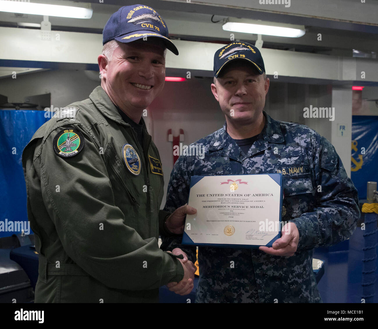 fords cvn 78 administrative officer receives a meritorious service medal from capt richard mccormack fords commanding officer us navy photo