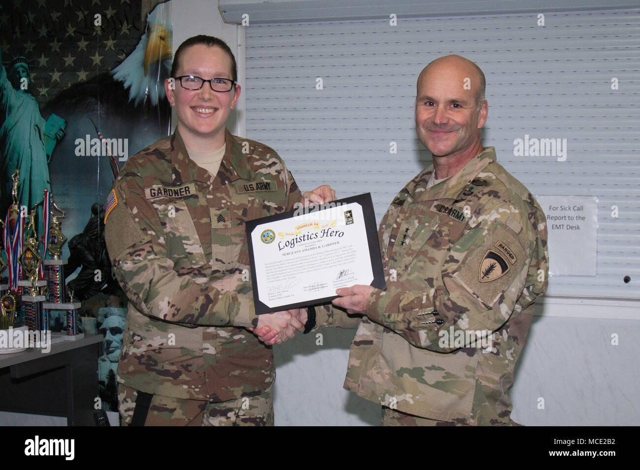 he U.S. Army Europe commanding general, Lt. Gen. Christopher Cavoli, presents a Logistics Hero certificate to Sgt. Amanda Gardner, a medical equipment maintainer, for her efforts in identifying and fixing outdated medical equipment stored at the MNBG-East medical facility on Camp Bondsteel. Stock Photo