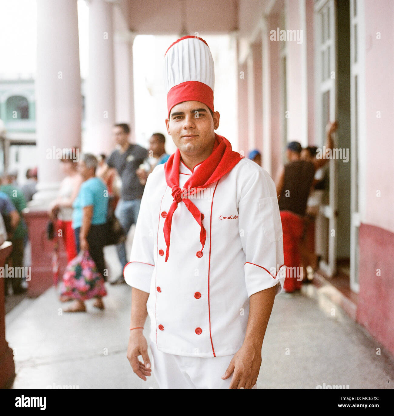 A chef at the cafeteria Canacuba poses for a portrait in the main square of Santa Clara, Cuba on Wednesday, December 3, 2015. The name of the cafeteria 'Canacuba' references Canada. Canada is very respected by Cubans, as it was one of the few countries not to break relations with Cuba following the revolution in 1959. - Stock Image