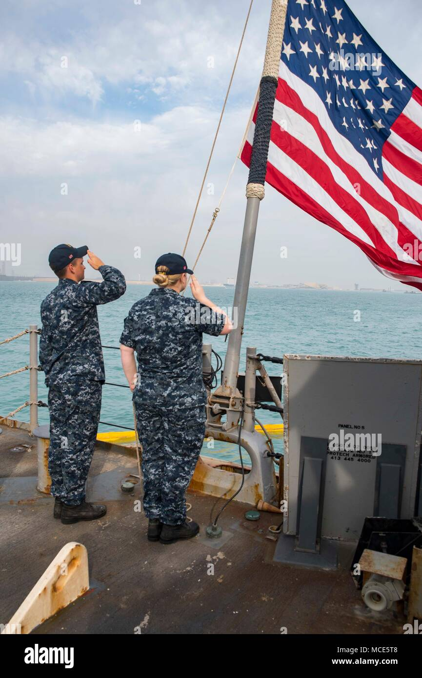 180218-N-DO281-0060 MANAMA, Bahrain (Feb. 18, 2018) Seaman Jacob Stricklin, left, and Hospital Corpsman 2nd Class Sarah Harrell salute the national ensign during morning colors aboard the guided-missile cruiser USS Monterey (CG 61). Monterey is deployed to the U.S. 5th Fleet area of operations in support of maritime security operations to reassure allies and partners and preserve the freedom of navigation and the free flow of commerce in the region. (U.S. Navy photo by Mass Communication Specialist Seaman Trey Fowler/Released) Stock Photo