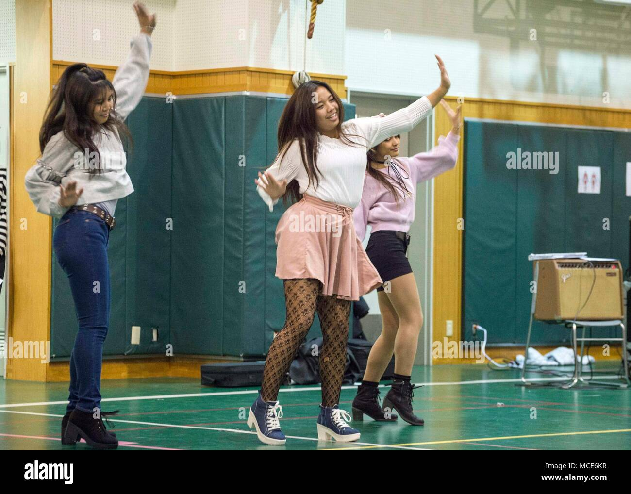 180223-N-LG762-164 YOKOSUKA, Japan (Feb. 23, 2018) K-Pop Dancers of Kinnick High preform during a Multicultural Night, Feb. 23.  The school's National Junior Honor Society (NJHS) hosted the unity-themed event which featured several performances from community members, local schools, and various performance groups. The student-led evening highlighted Dr. Martin Luther King's message of equality while celebrating Black History Month. (U.S. Navy photo by Mass Communication Specialist 2nd Class Zhiwei Tan/Released) Stock Photo
