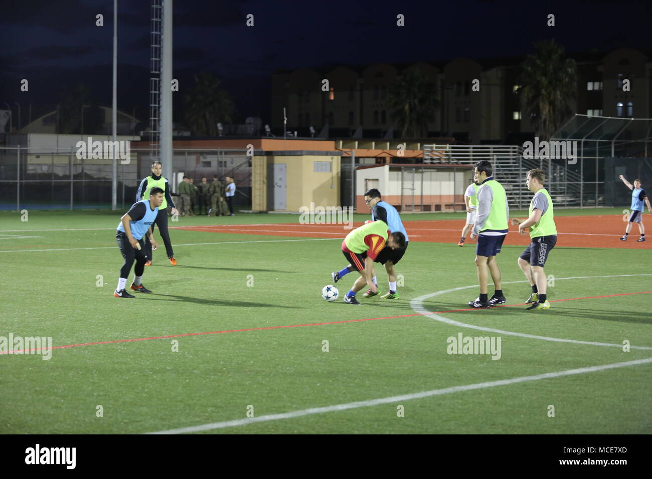 A U.S. Marine assigned to Special Purpose Marine Air-Ground Task Force Crisis-Response-Africa fights for ball possession against an opponent during Naval Aviation Station soccer tournament aboard NAS Sigonella, Italy, Feb. 12, 2018. SPMAGTF-CR-AF is deployed to conduct crisis-response and theater-security operations in Europe and Africa. (U.S. Marine Corps photo by Cpl. Patrick Osino) - Stock Image
