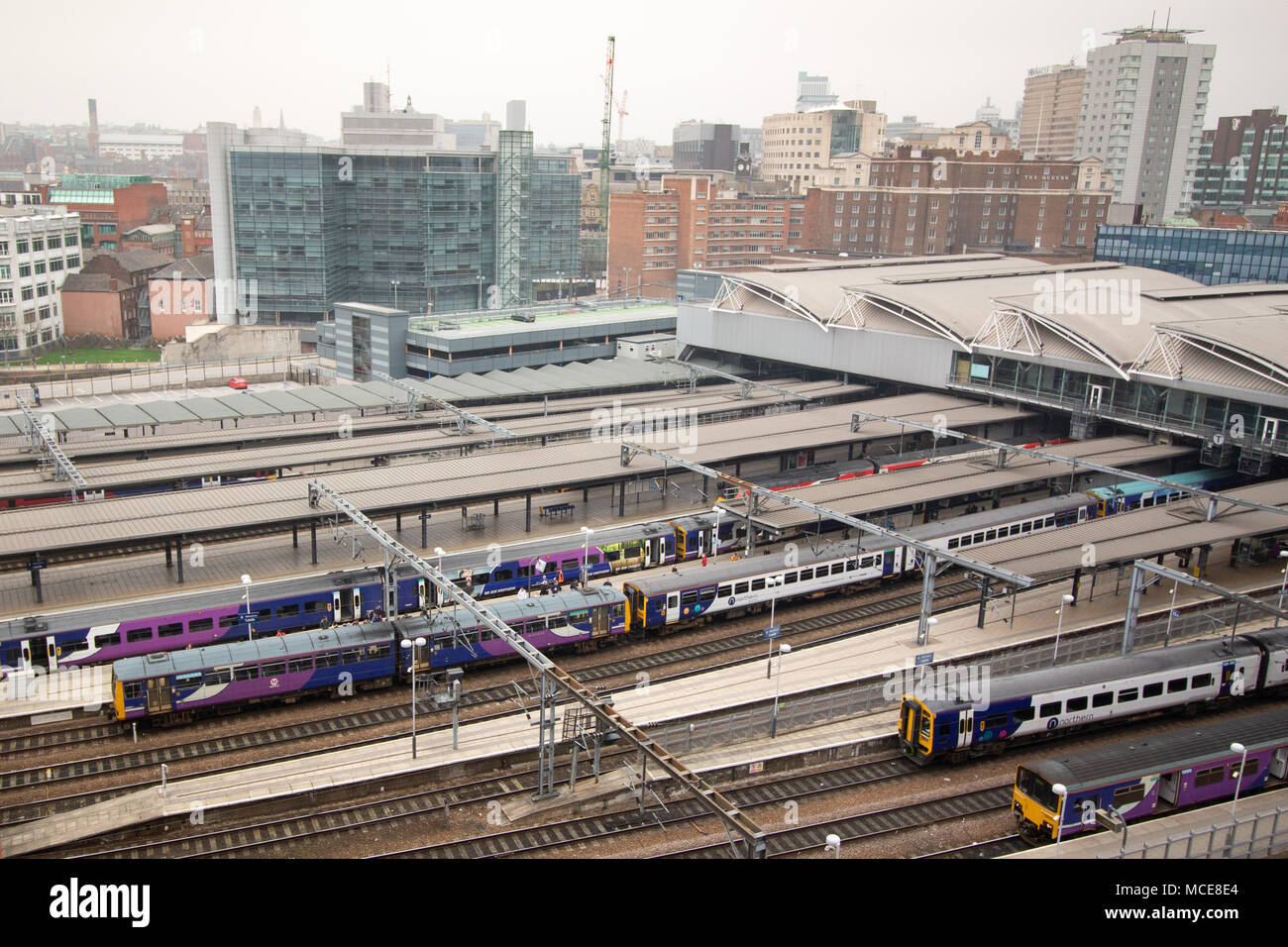Leeds Central railway station seen from the top of the nearby Hilton Double Tree Hotel in the city centre. - Stock Image