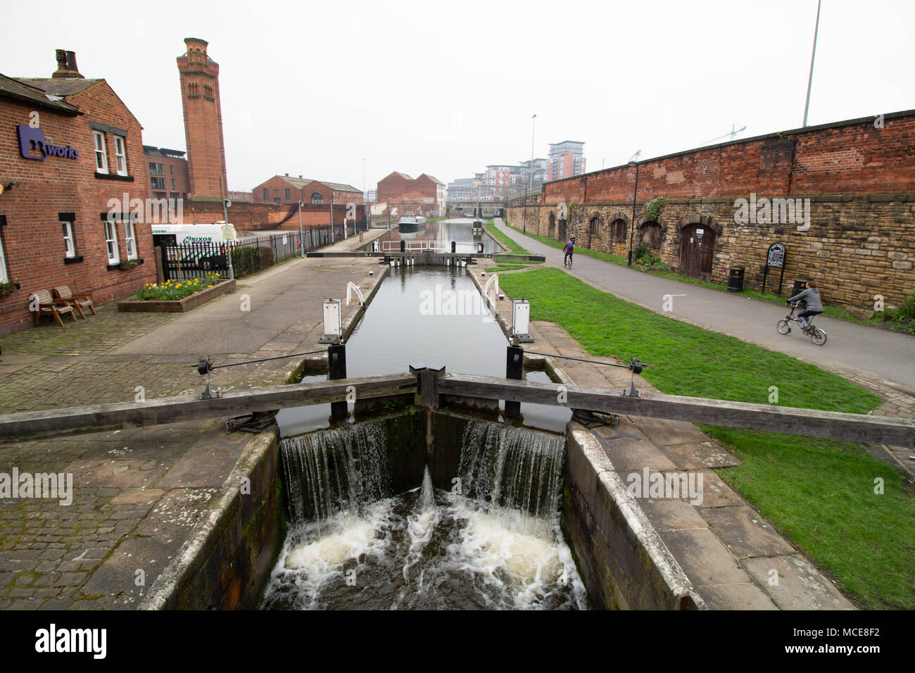 The Leeds and Liverpool canal pictured in Leeds City Centre taken from Wharf approach bridge looking westwards. - Stock Image