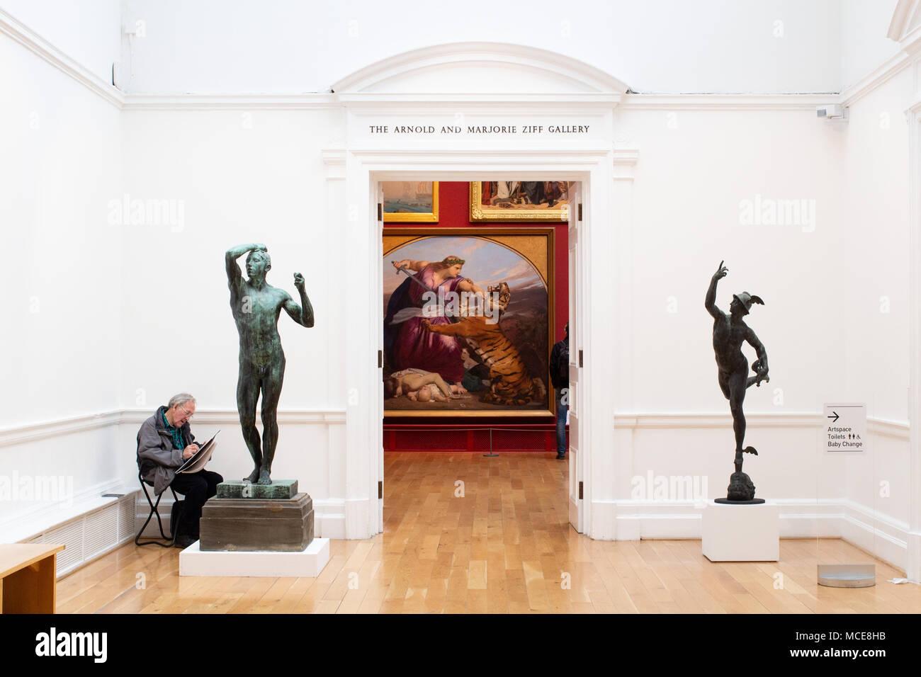 An artist sketching a statue of Mercury in Leeds art gallery Stock Photo