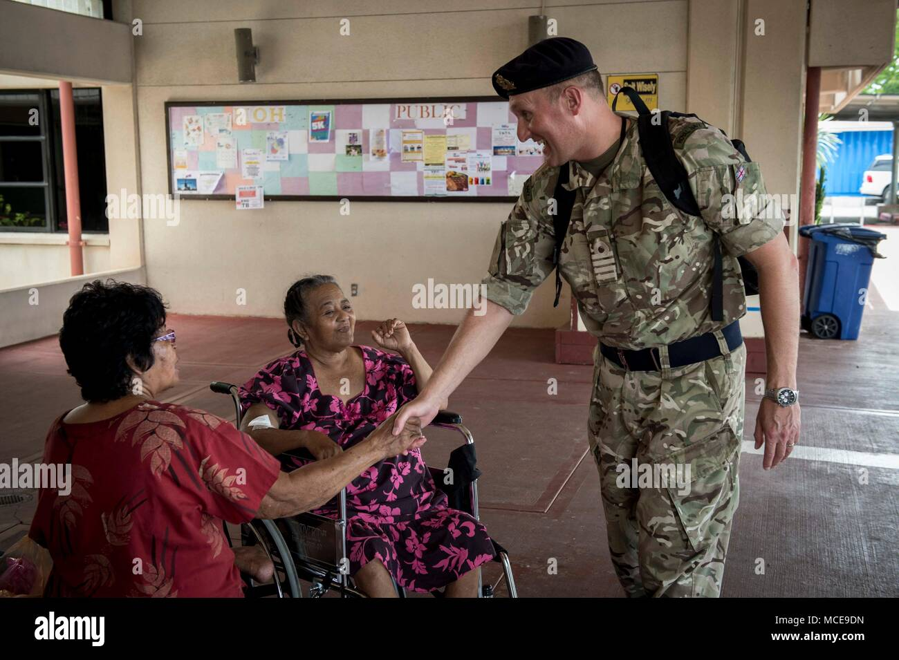 180409-N-MW694-0090 KOROR, Palau (April 09, 2018) Royal Navy Capt. Peter Olive, Pacific Partnership 2018 (PP18) Deputy Mission Commander, introduces himself to patients at Belau National Hospital during a PP18 medical subject matter exchange, April 9. PP18's mission is to work collectively with host and partner nations to enhance regional interoperability and disaster response capabilities, increase stability and security in the region, and foster new and enduring friendships across the Indo-Pacific Region. Pacific Partnership, now in its 13th iteration, is the largest annual multinational hum - Stock Image