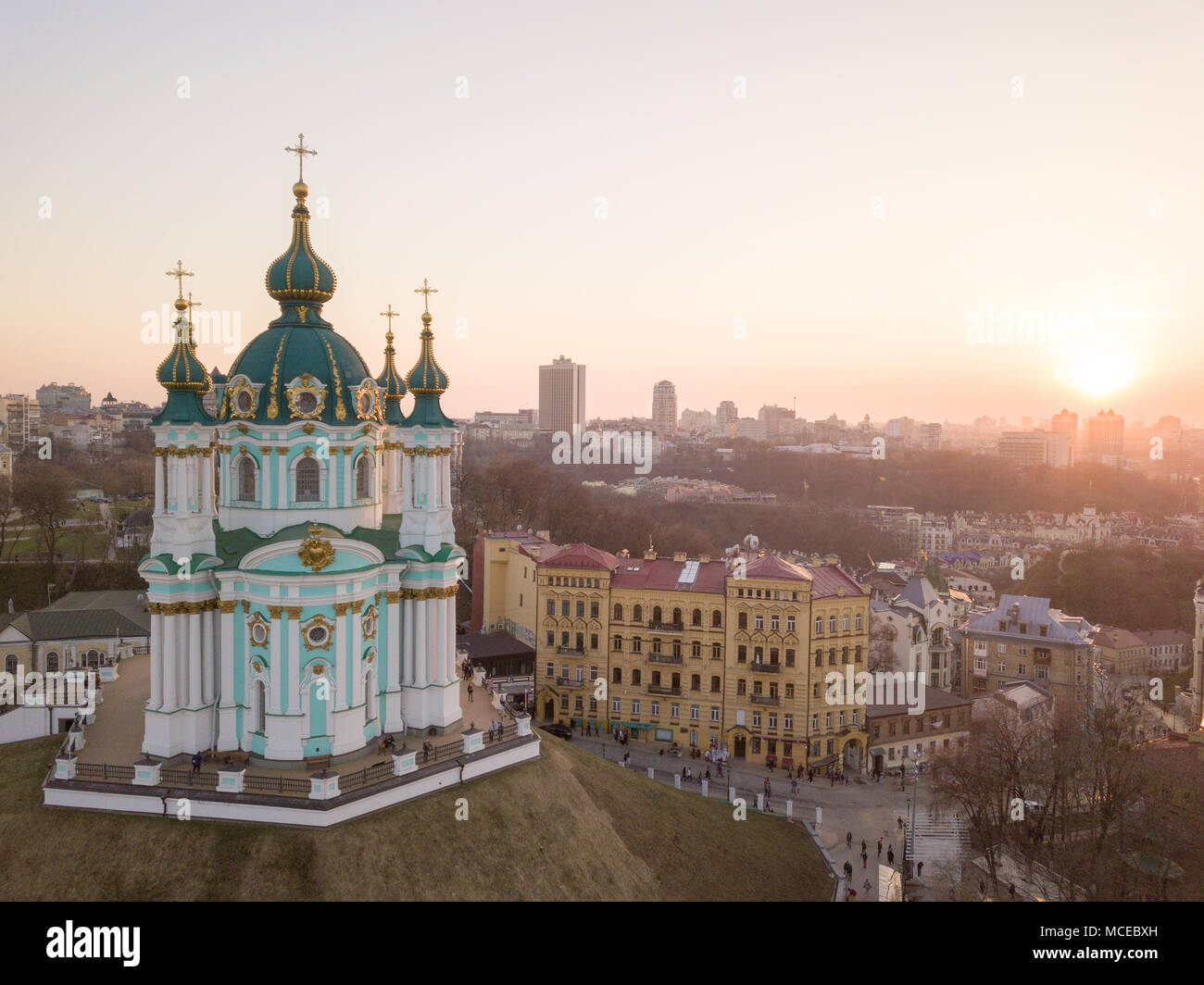 Aerial top view of Saint Andrew's church and Andreevska street, cityscape of Podol district city of Kiev , Ukraine. Drone photo Stock Photo