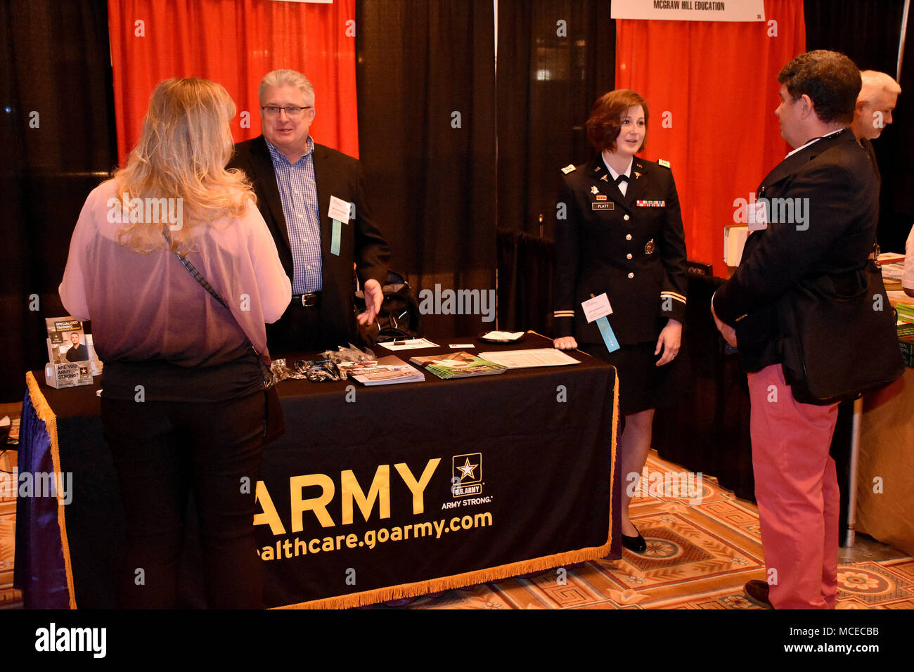 Bruce Schamburek, education services specialist for the 6th Medical Recruiting Battalion, and Captain Katie Flatt, U.S. Army health care recruiter from the Aurora Medical Recruiting Station, speak to attendees of the Trauma, Critical Care & Acute Care Surgery Conference at Caesars Palace on 10 April. Schamburek and Flatt were on hand, along with members of the Las Vegas Medical Recruiting Station, to explain the benefits and opportunities of a career in Army Medicine. For more information on the Army's more than 80 medical specialties go to healthcare.goarmy.com. (U.S. Army Photo by Andrew Lyn - Stock Image